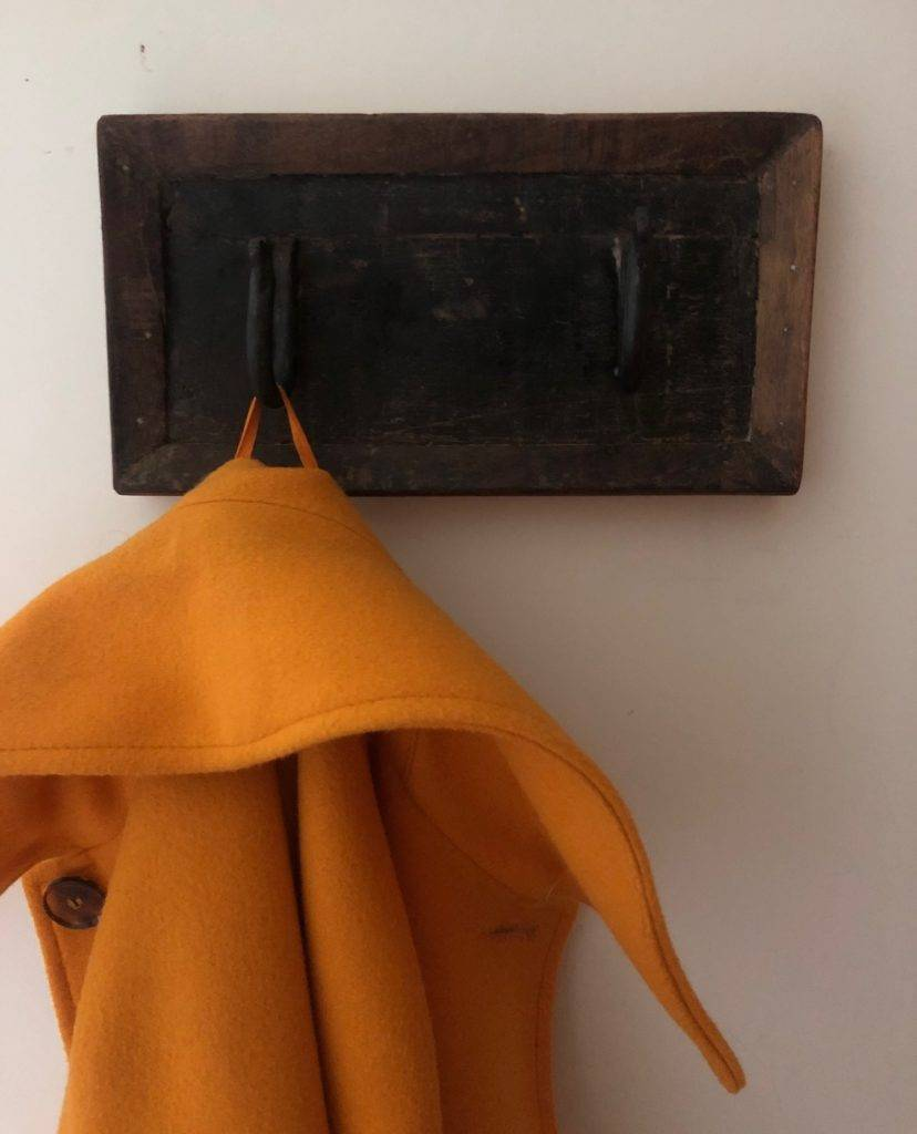 two hooks coat hanger with orange coat