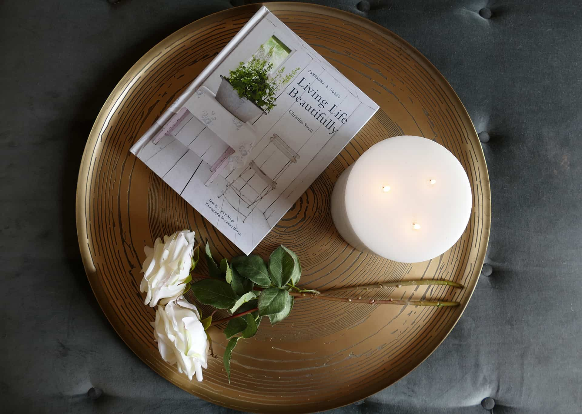 brass tray with candle and flowers