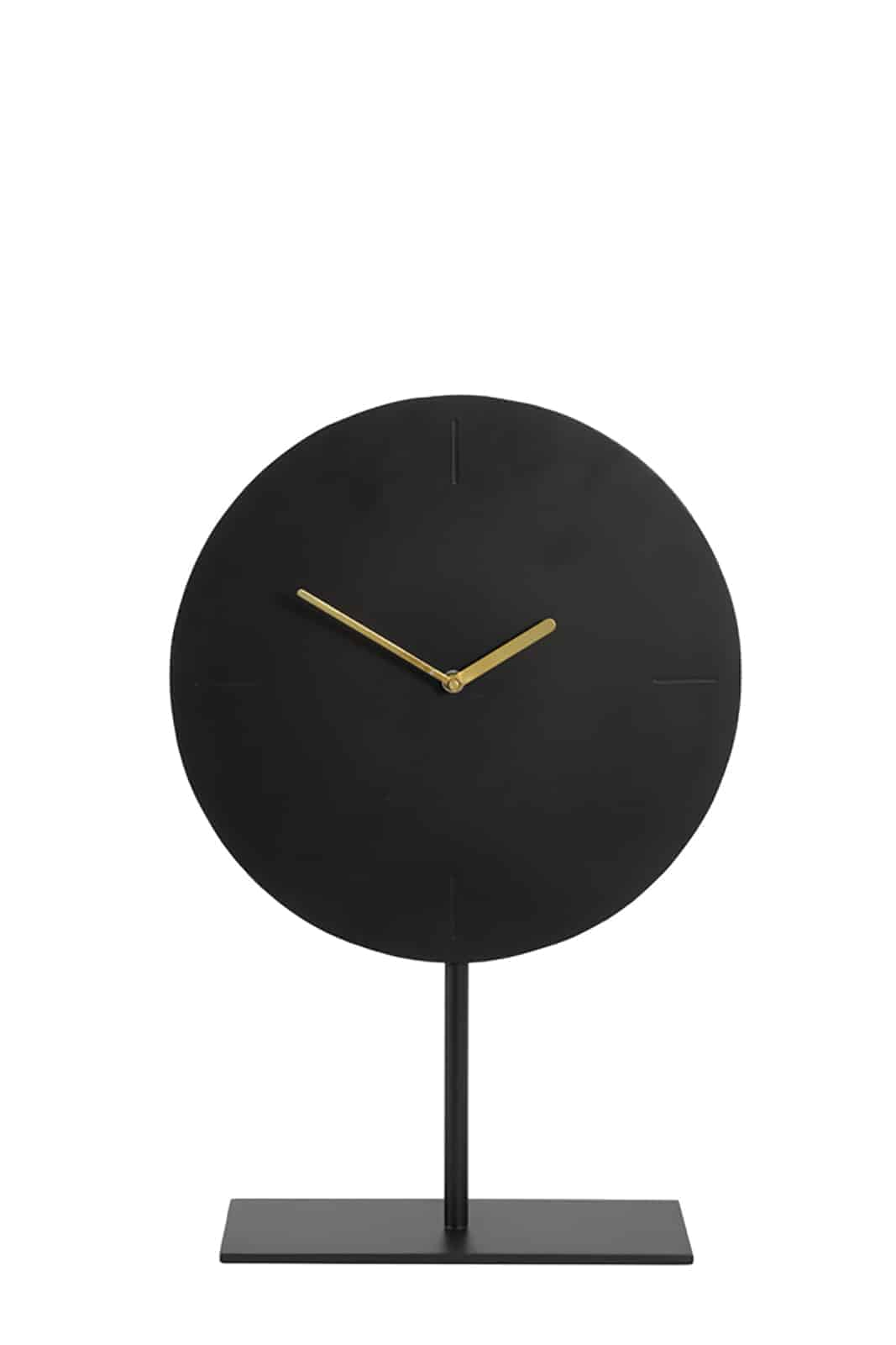 round black clock with gold handles on stand