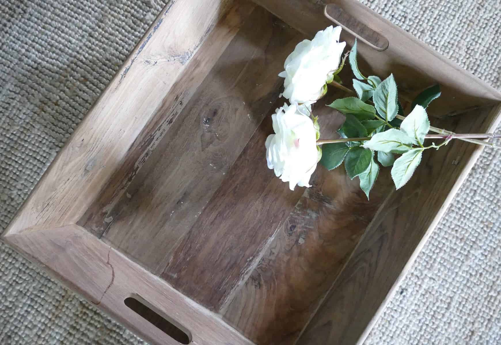 wooden serving tray with white roses