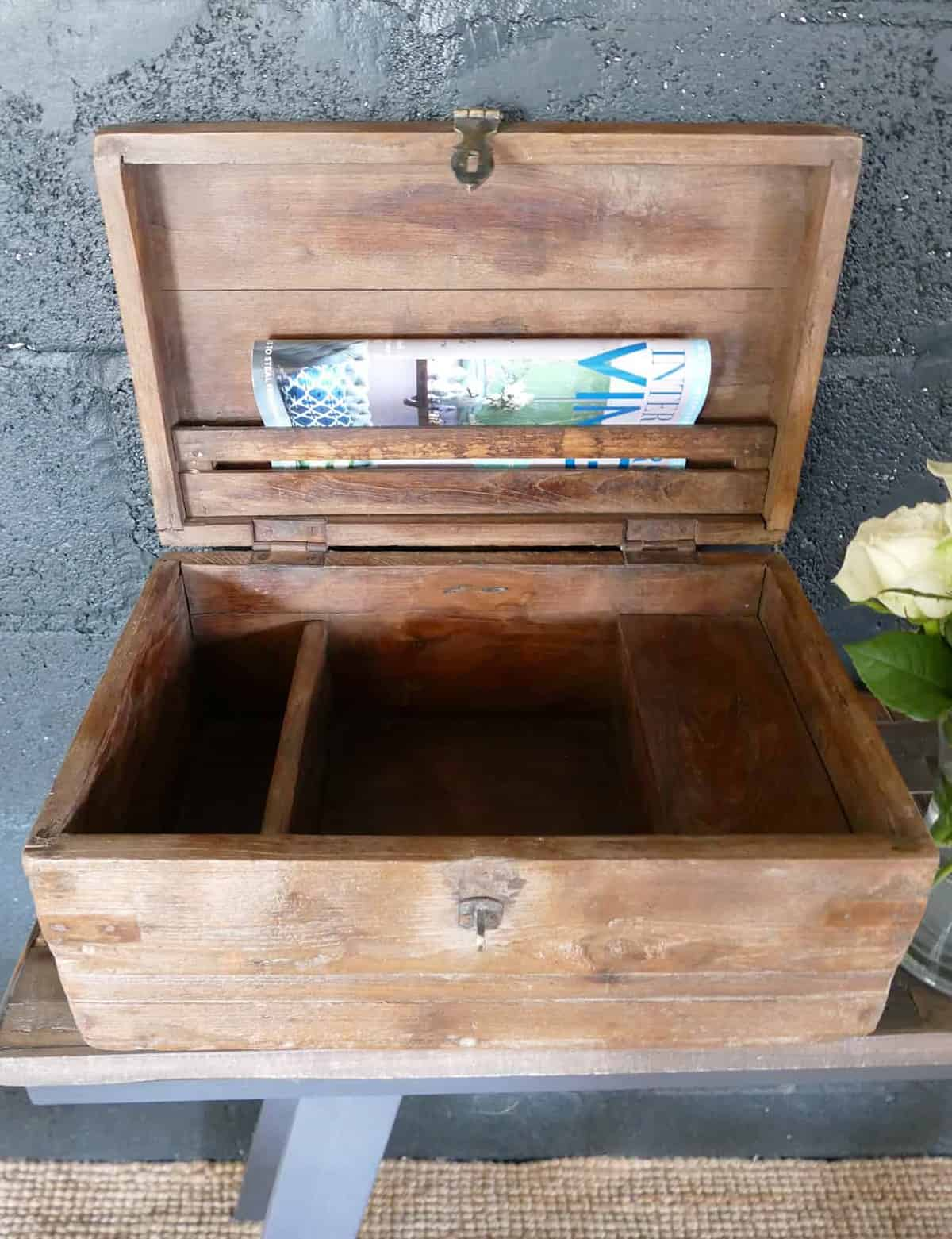 wooden open chest with magazine