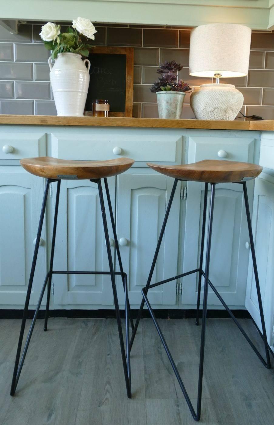 teak bar stools at counter