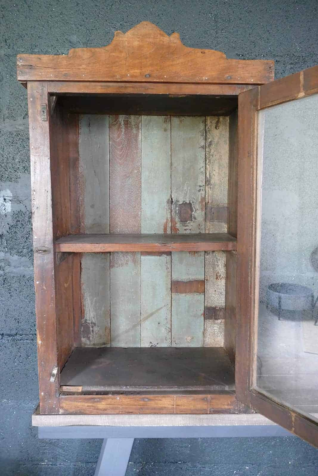 wooden medicine cabinet with open door