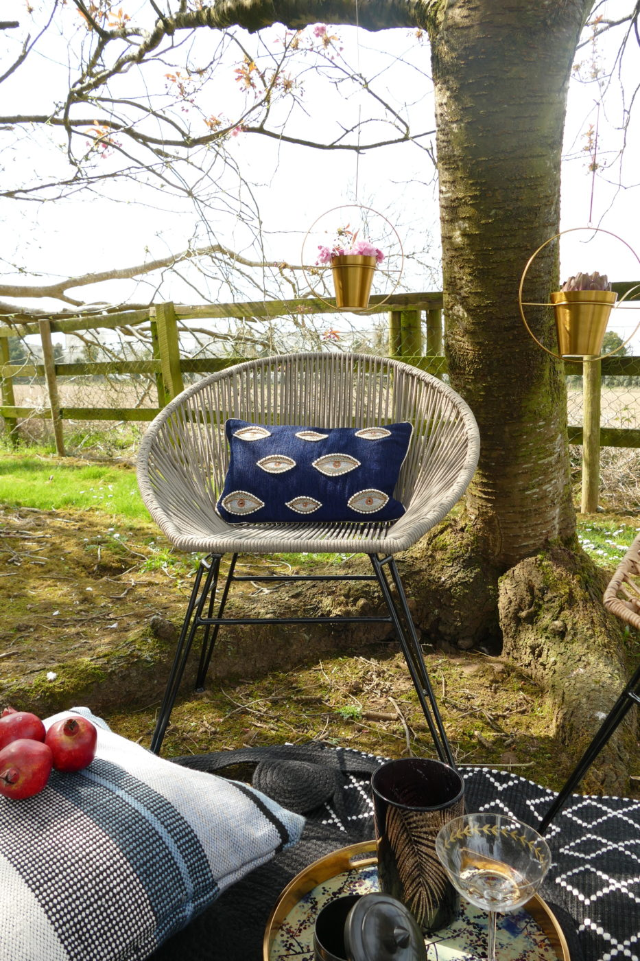 outdoor rope chair with dark blue cushion with stitched eyes