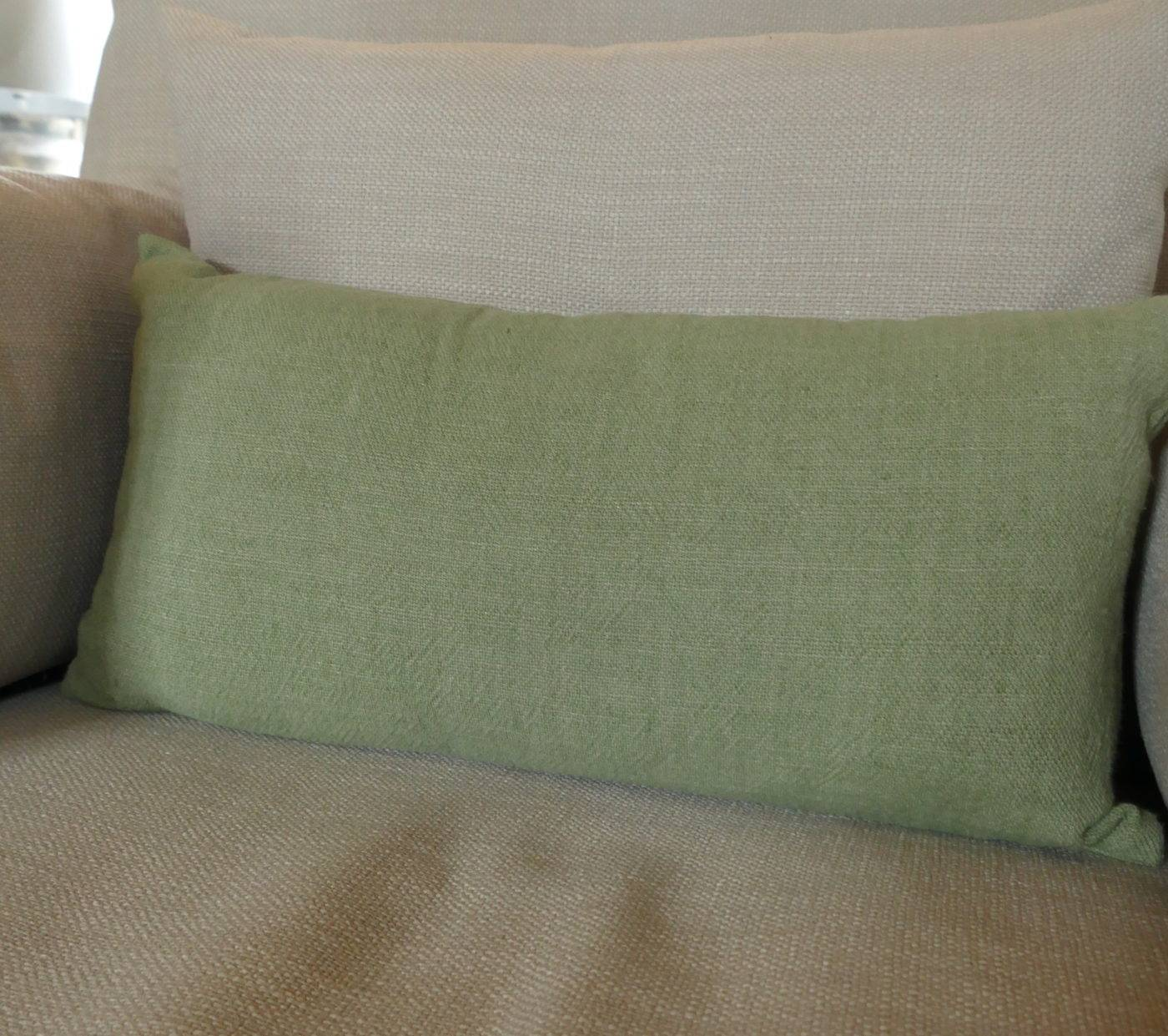 green twill rectangular cushion on sofa