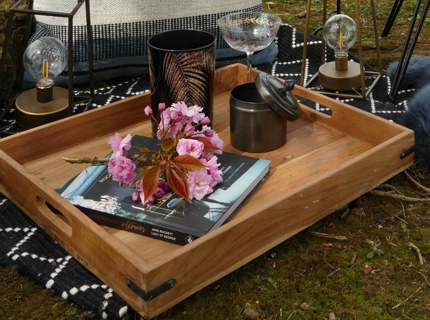 elements upright tray with flowers and book