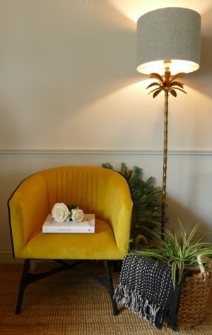 velvet mustard chair in room with lamp subang rattan lounger sold by stagers lifestyle