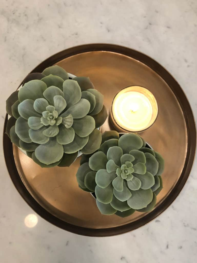 Copper tray display with plant and candle