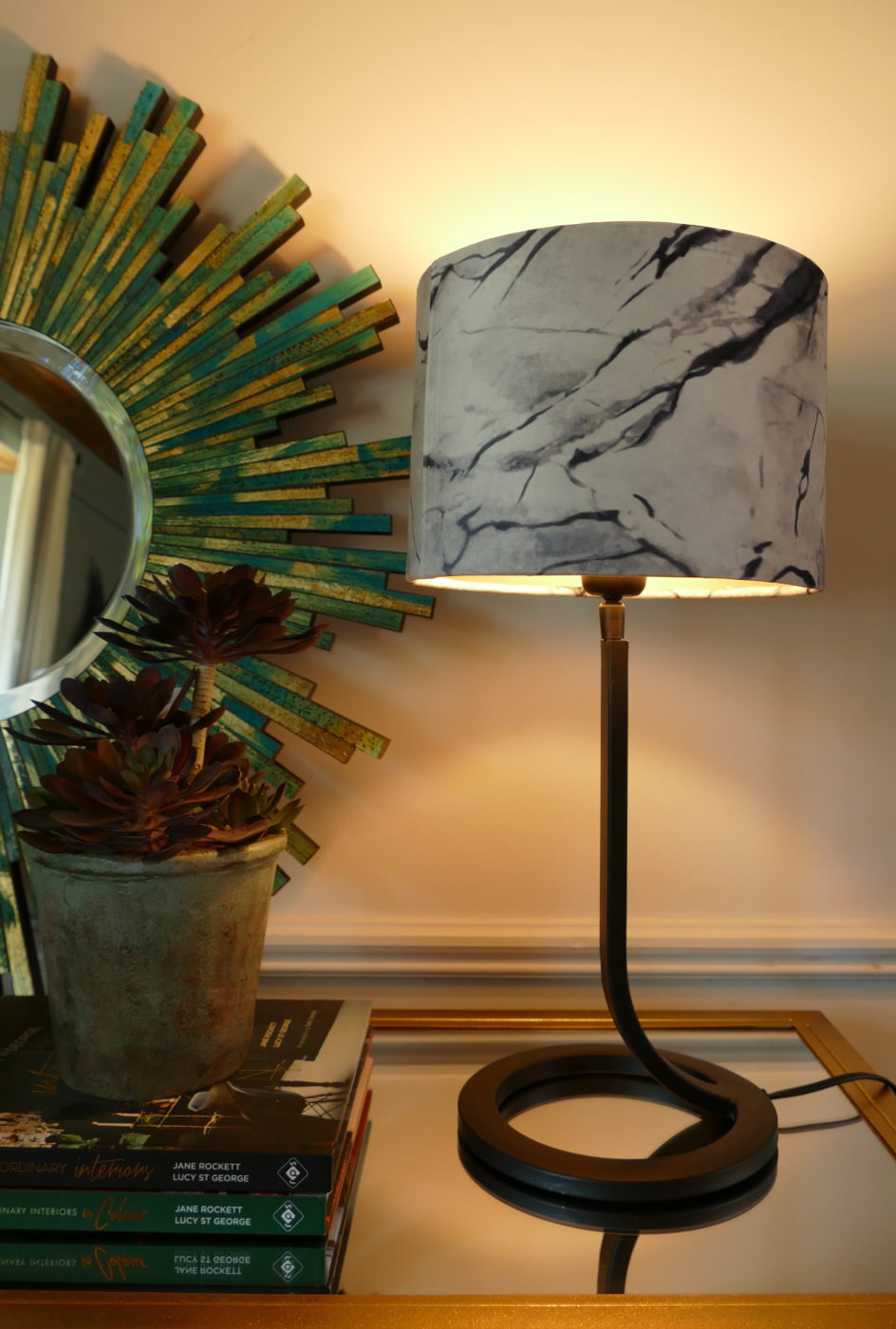 lamp with marble shade on side table