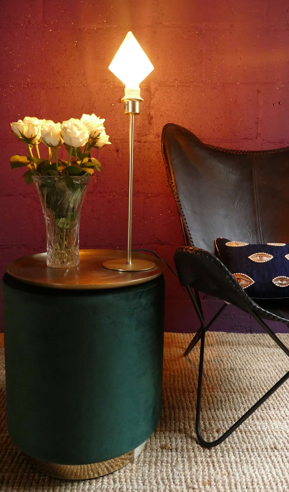 green foot stool and black leather chair