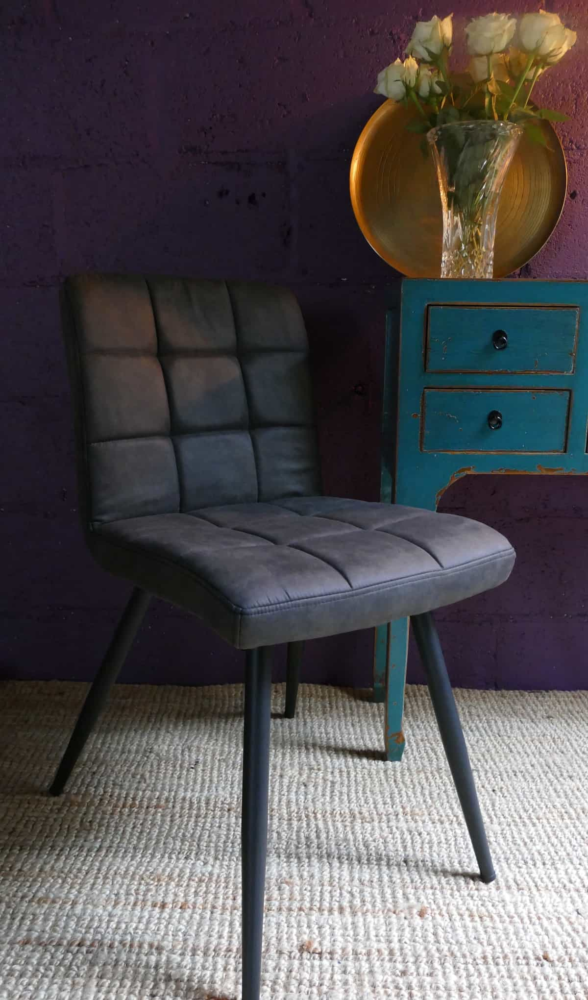padded chair and blue dresser