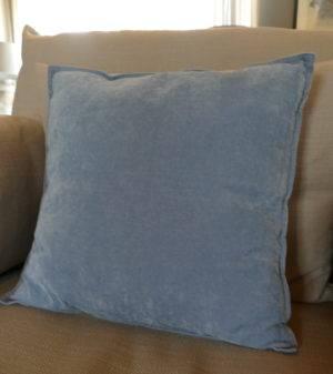 velvet skylight blue cushion on sofa