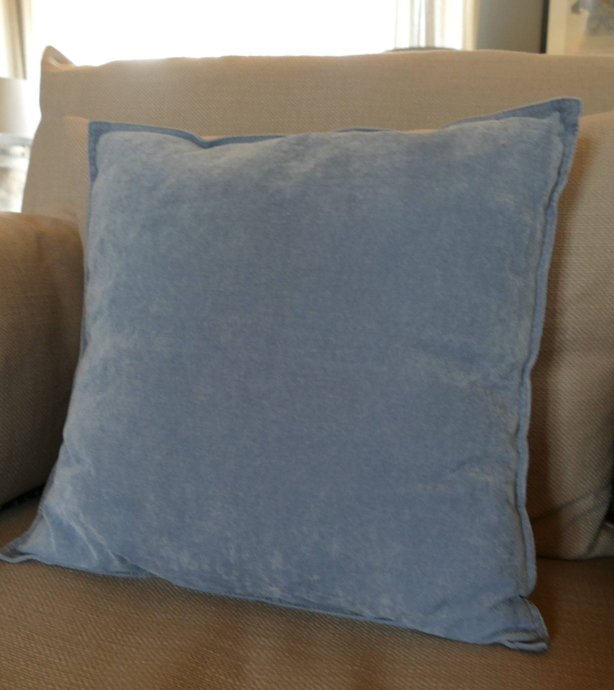 velvet skylight blue cushion on sofa