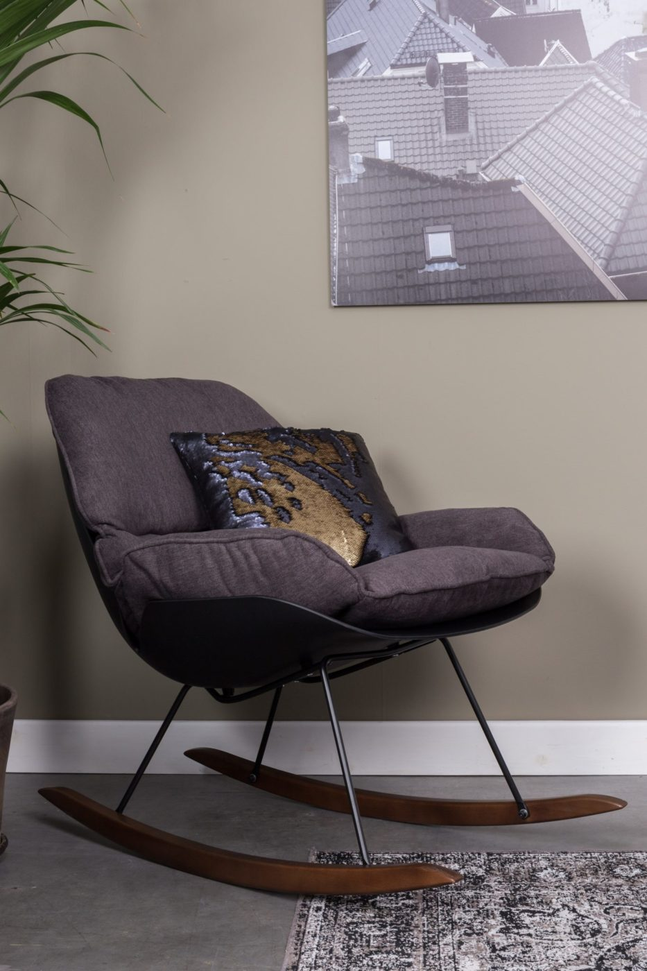 brown rocking chair with gold and black cushion