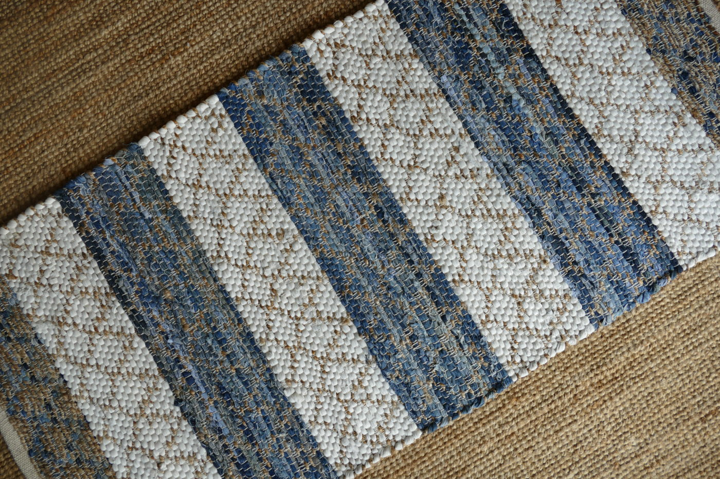 white gold and blue woven rug