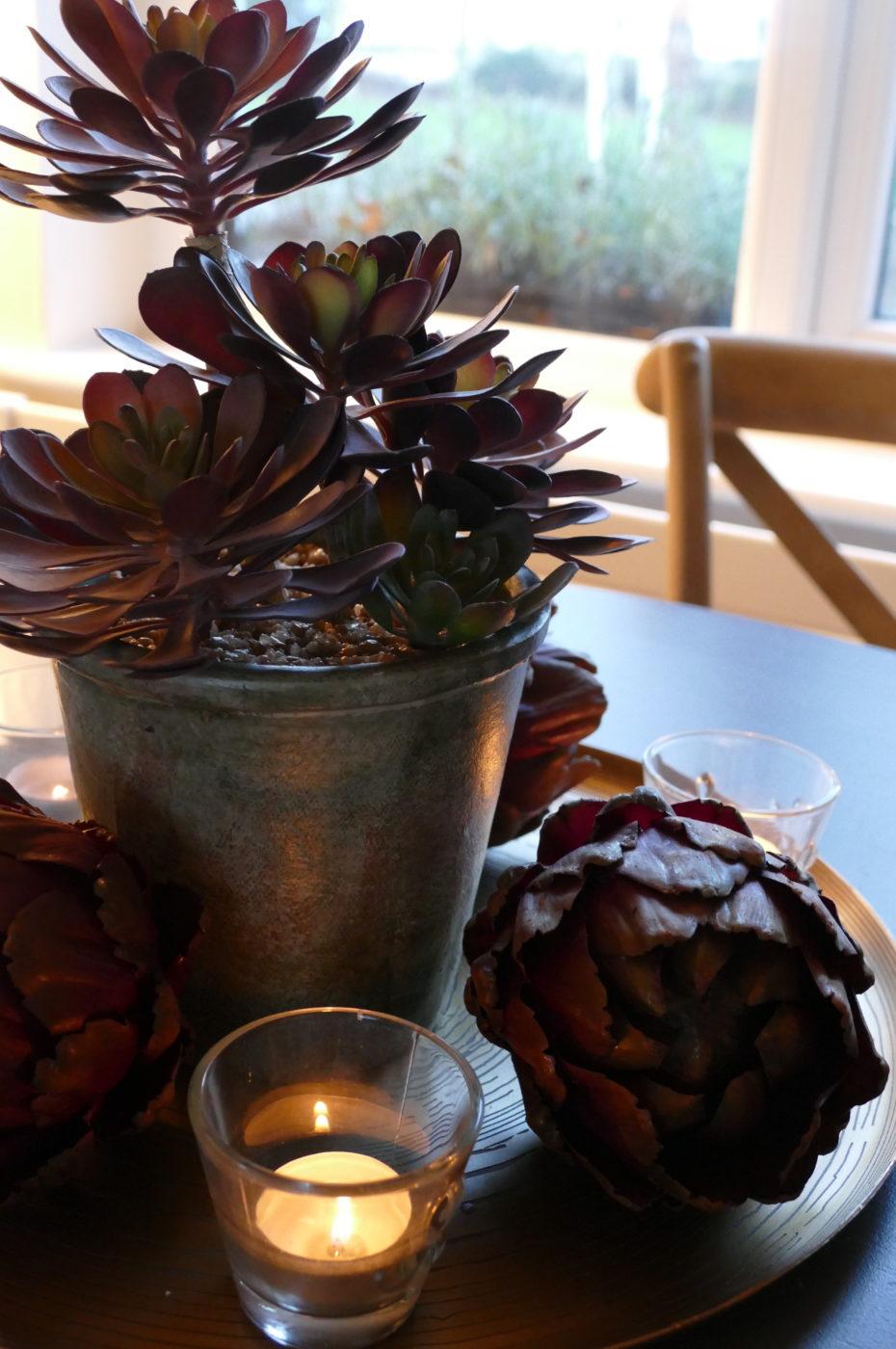 fake carciofi plant beside candle
