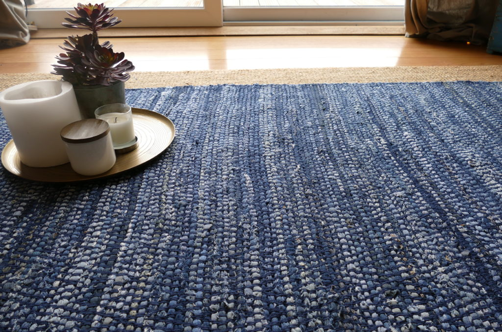 blue white and black woven rug