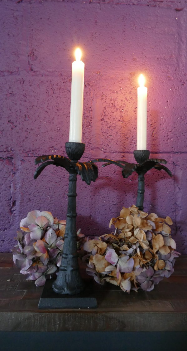 lit candle sticks palm tree design