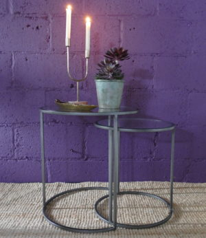 side tables grey edge with lit candles and plant view