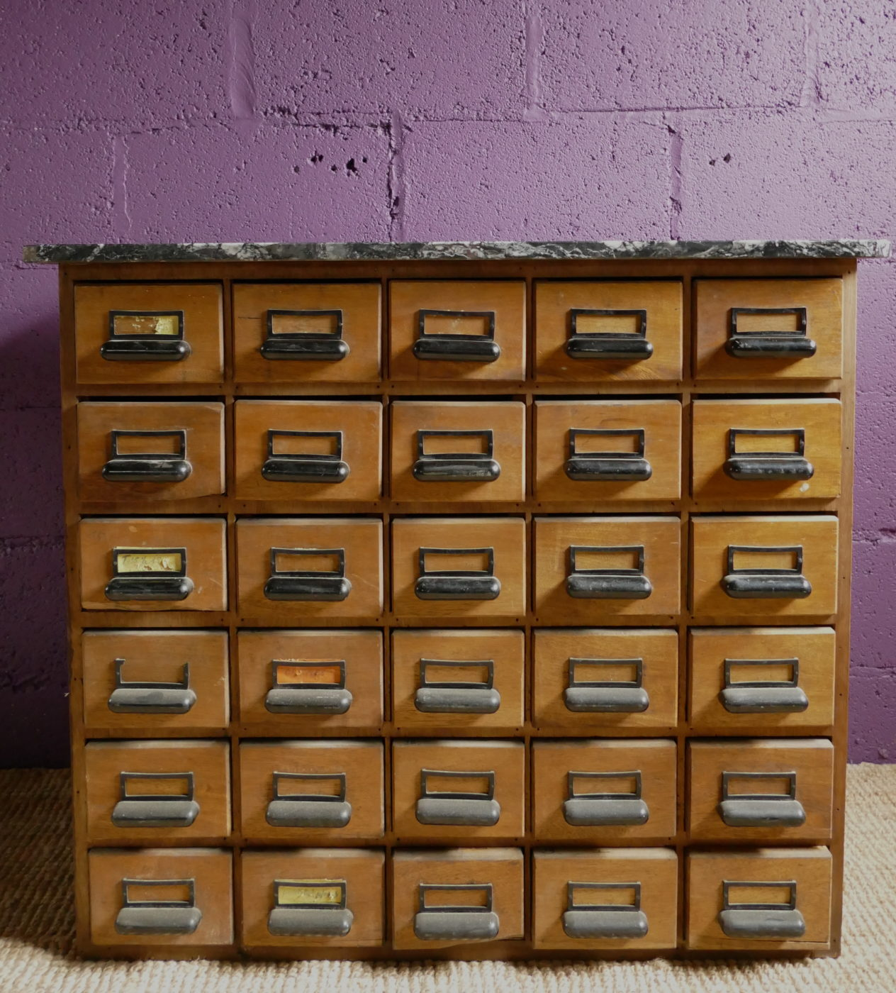 drawers and purple wall