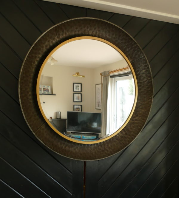 metal round mirror on black wall