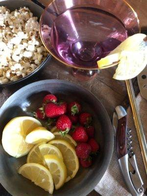 military style bowls with fruit and popcorn
