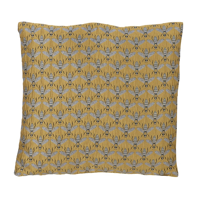 gold cushion with stitched bee design
