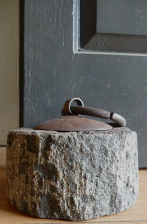 stone doorstop against door