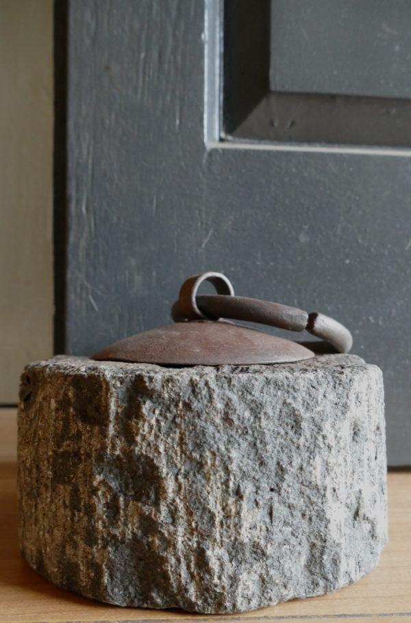stone doorstop against door