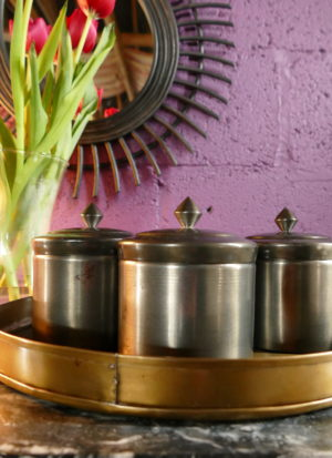 brass storage posts on tray sold by stagers lifestyle