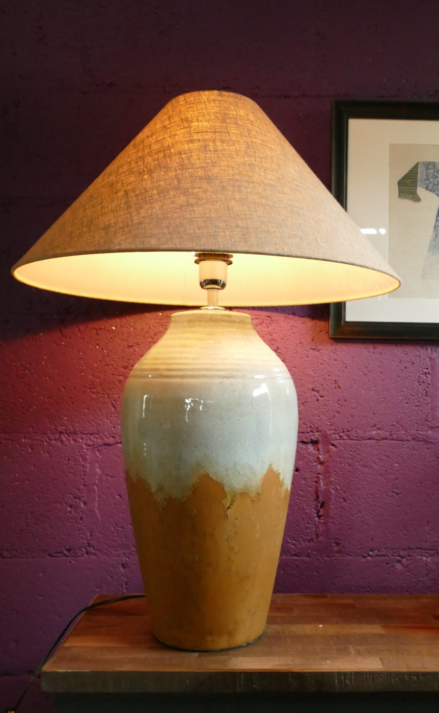 white and orange lamp on table