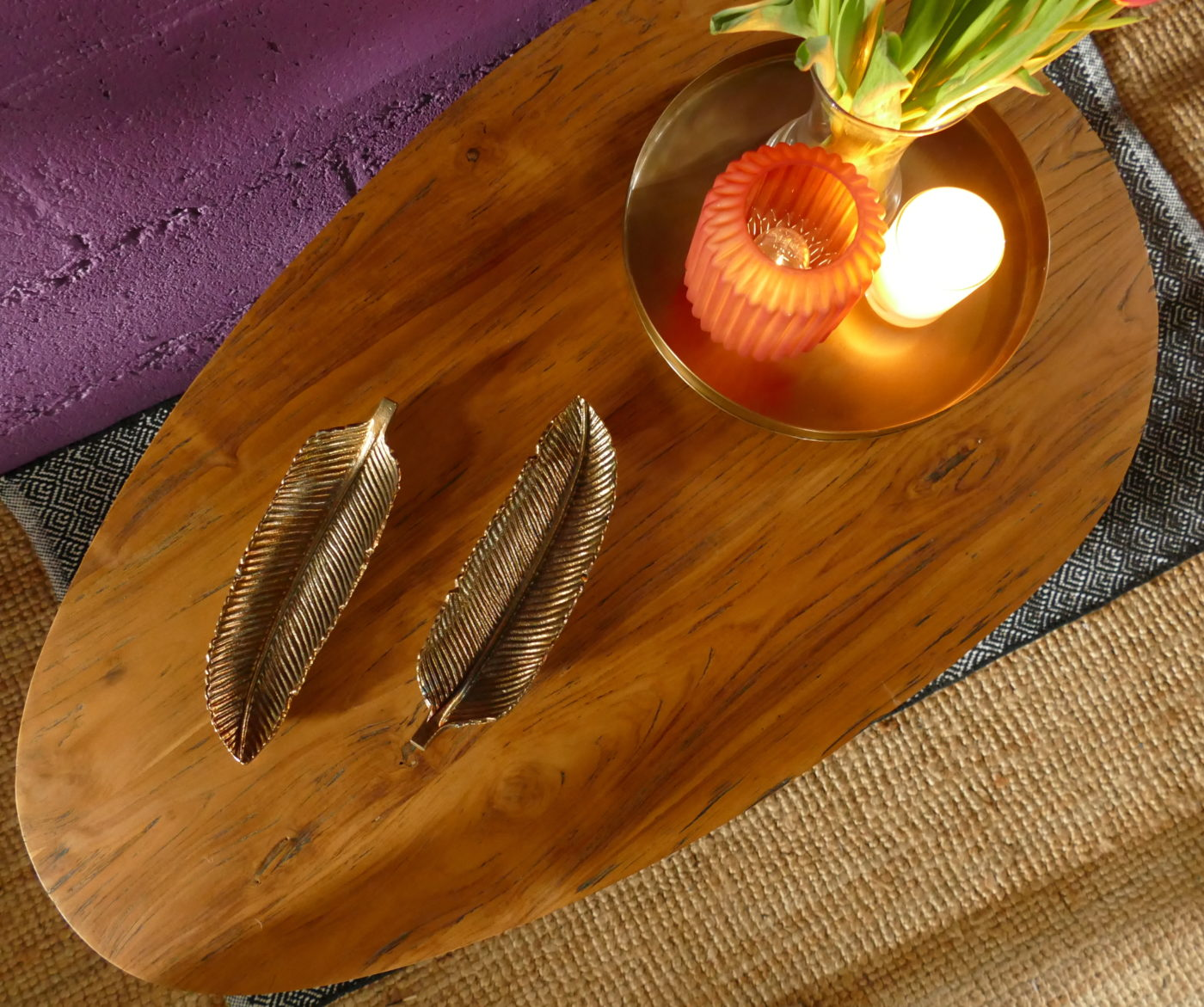 egg shaped table with candles and leaf bowls