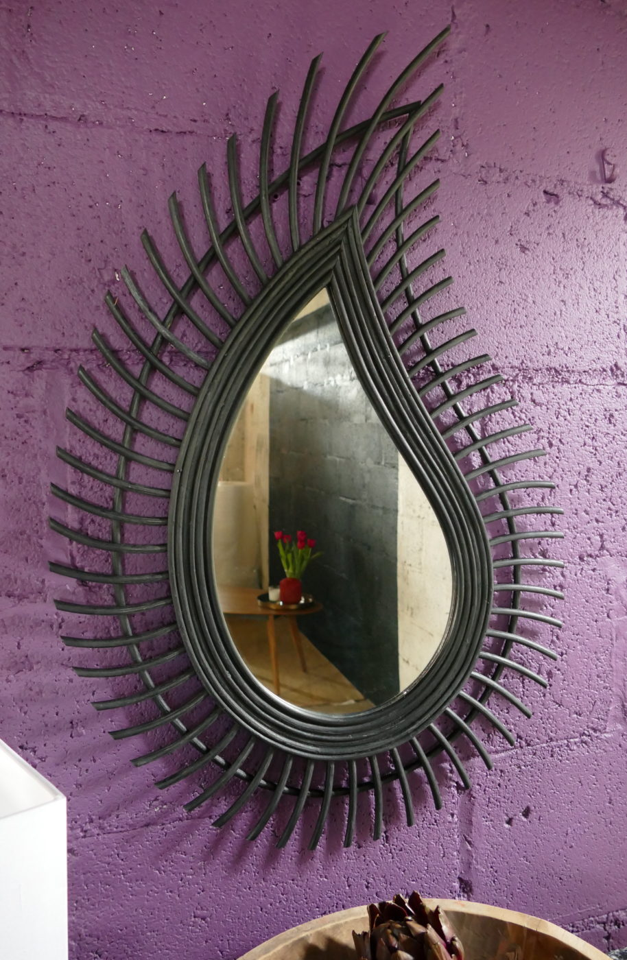 teardrop shaped mirror against purple wall sold by stagers lifetyle