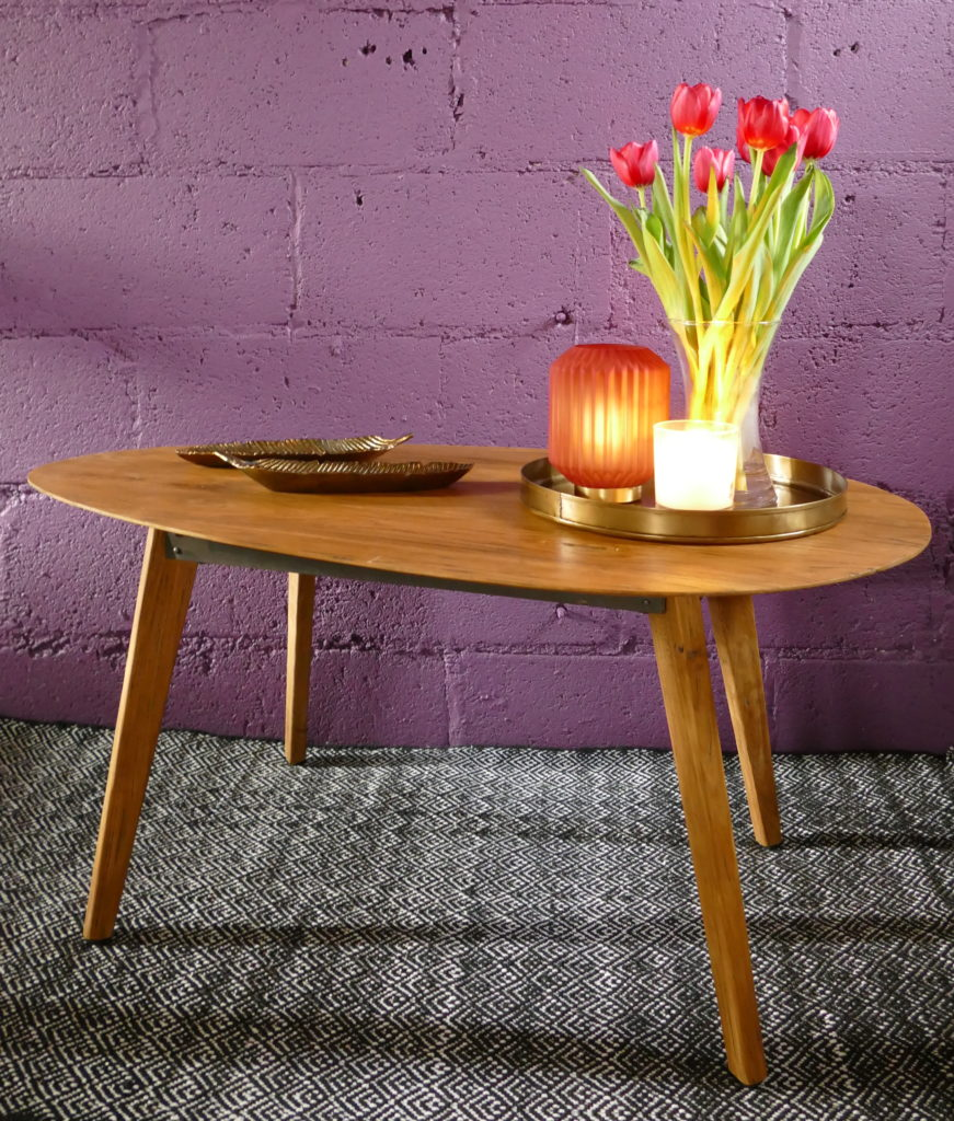 egg shaped wooden coffee table with red tulips