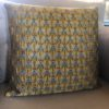 golden bee cushion on a sofa