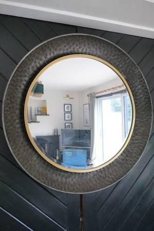 hammered metal round wall mirror