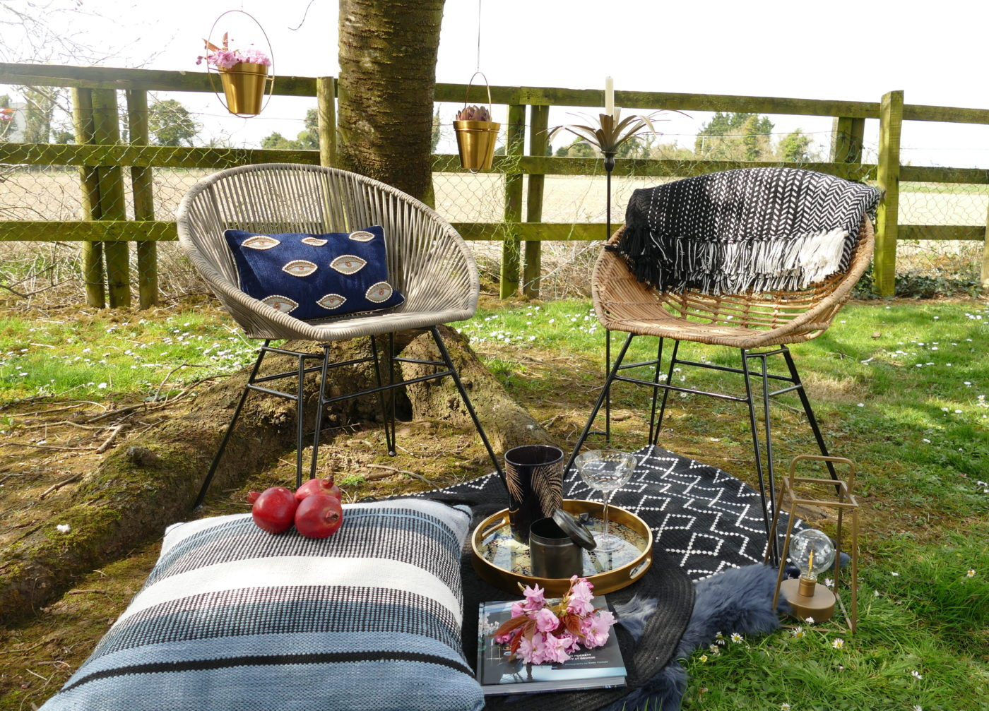 outdoor chairs on blanket with cushion