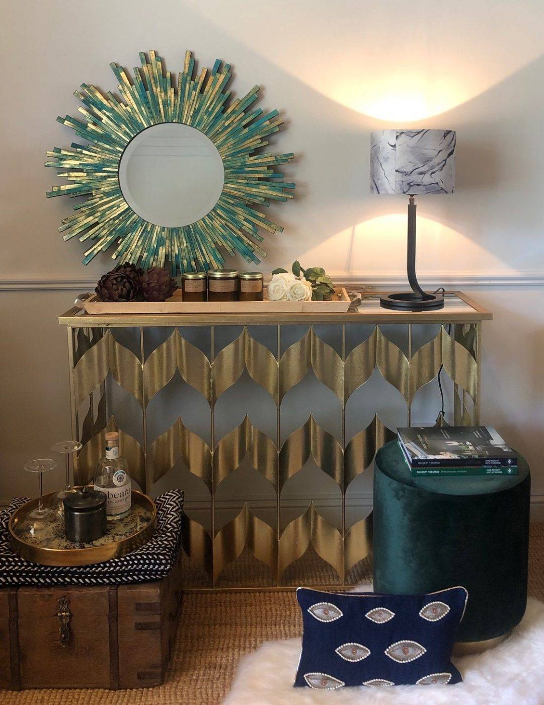 turquoise blue mirror on gold table with marble lamp