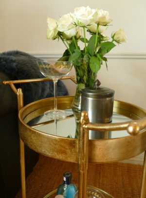 gold drinks trolley and martini glass