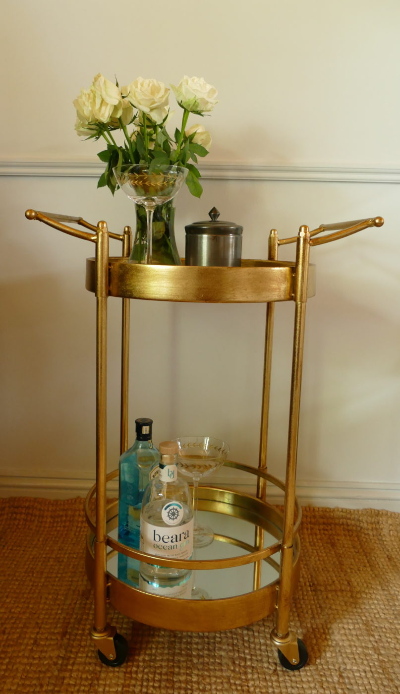 gold drinks trolley with martini glass and bombay sapphire