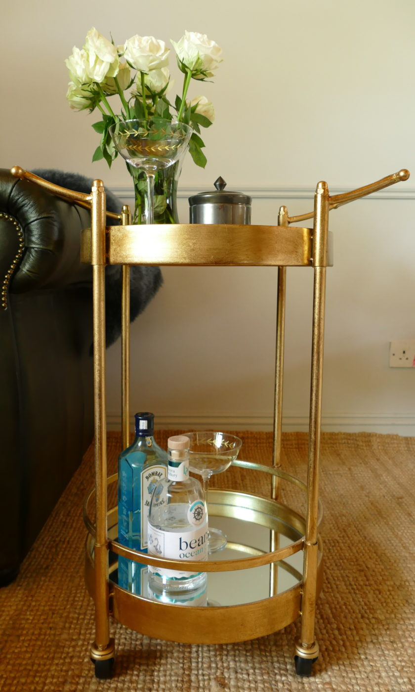gold drinks trolley with bombay sapphire