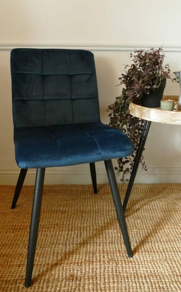 olive velvet blue dining chair on carpet