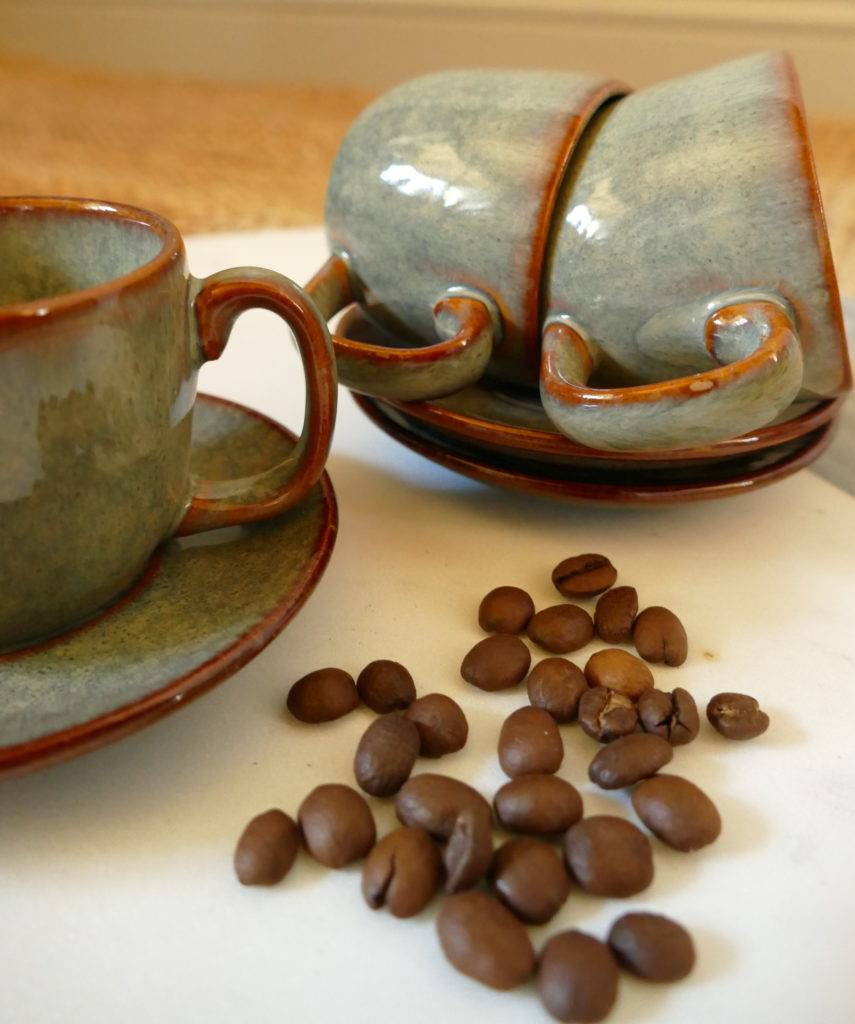 espresso cups and saucers with coffee beans
