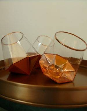 tilting glass tumblers on tray