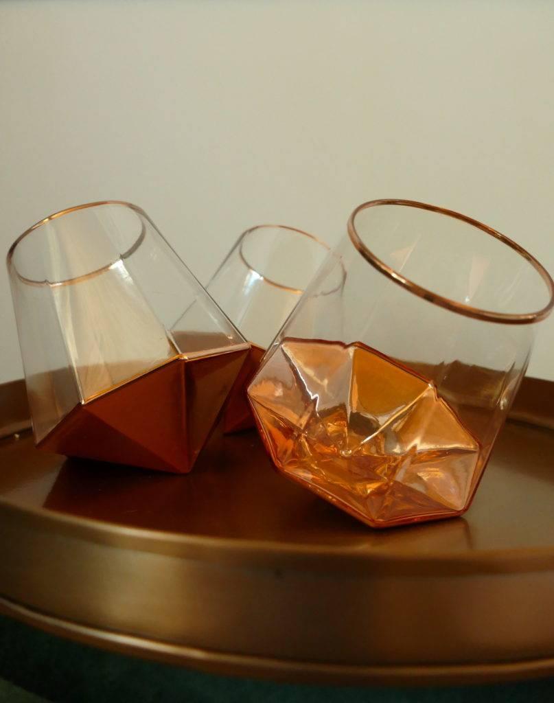 tilted tumbler glasses on tray