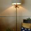 Armata bronze floor lamp in room turned on