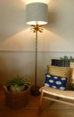 Armata bronze floor lamp in room turned on