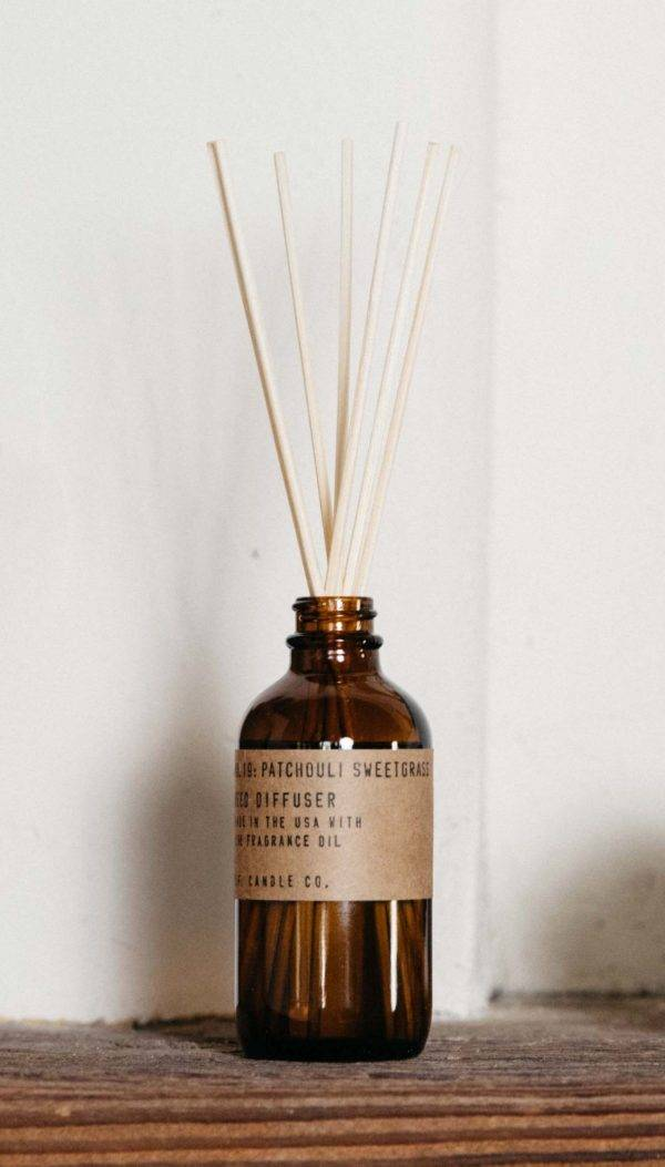 diffuser patchouli sweetgrass sitting on shelf