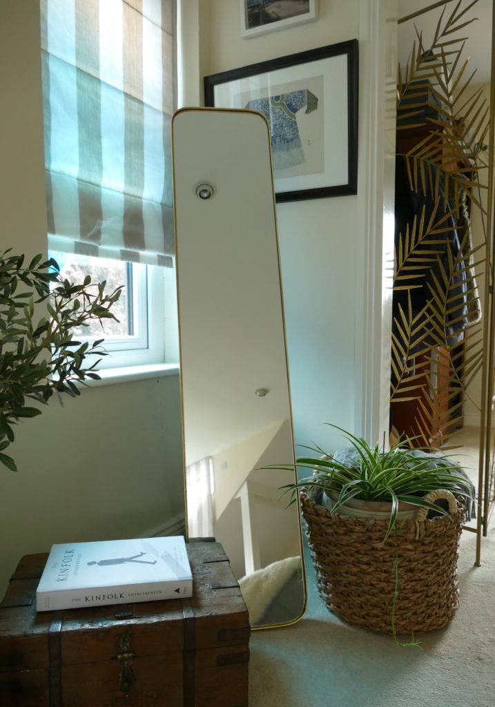 gold floor standing mirror in room with seagrass basket subang rattan lounger sold by stagers lifestyle