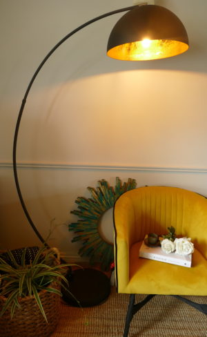 half moon floor lamp and Velvet mustard chair and large iron lamp turned on